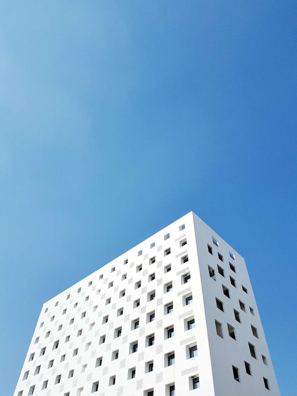 white painted building under blue sky