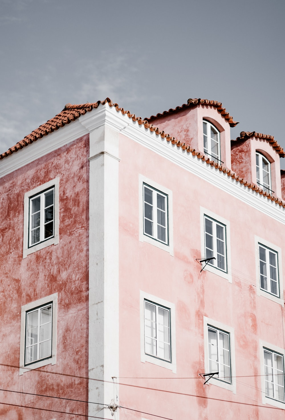 low angle photography of pink and red building structure