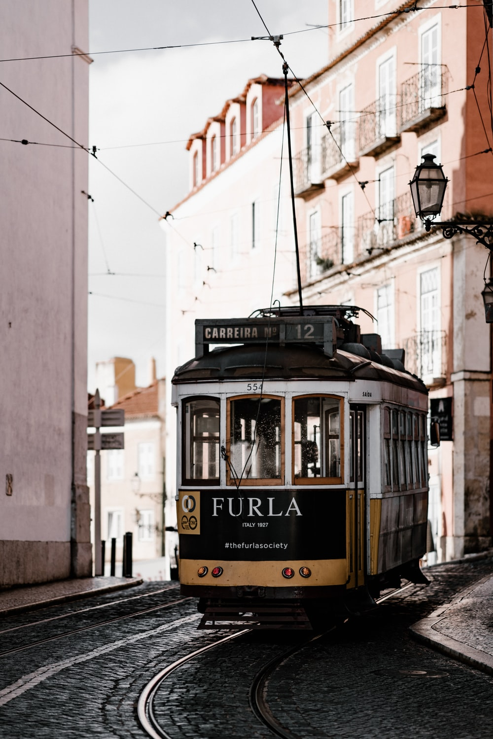 white and yellow Furla train at daytime