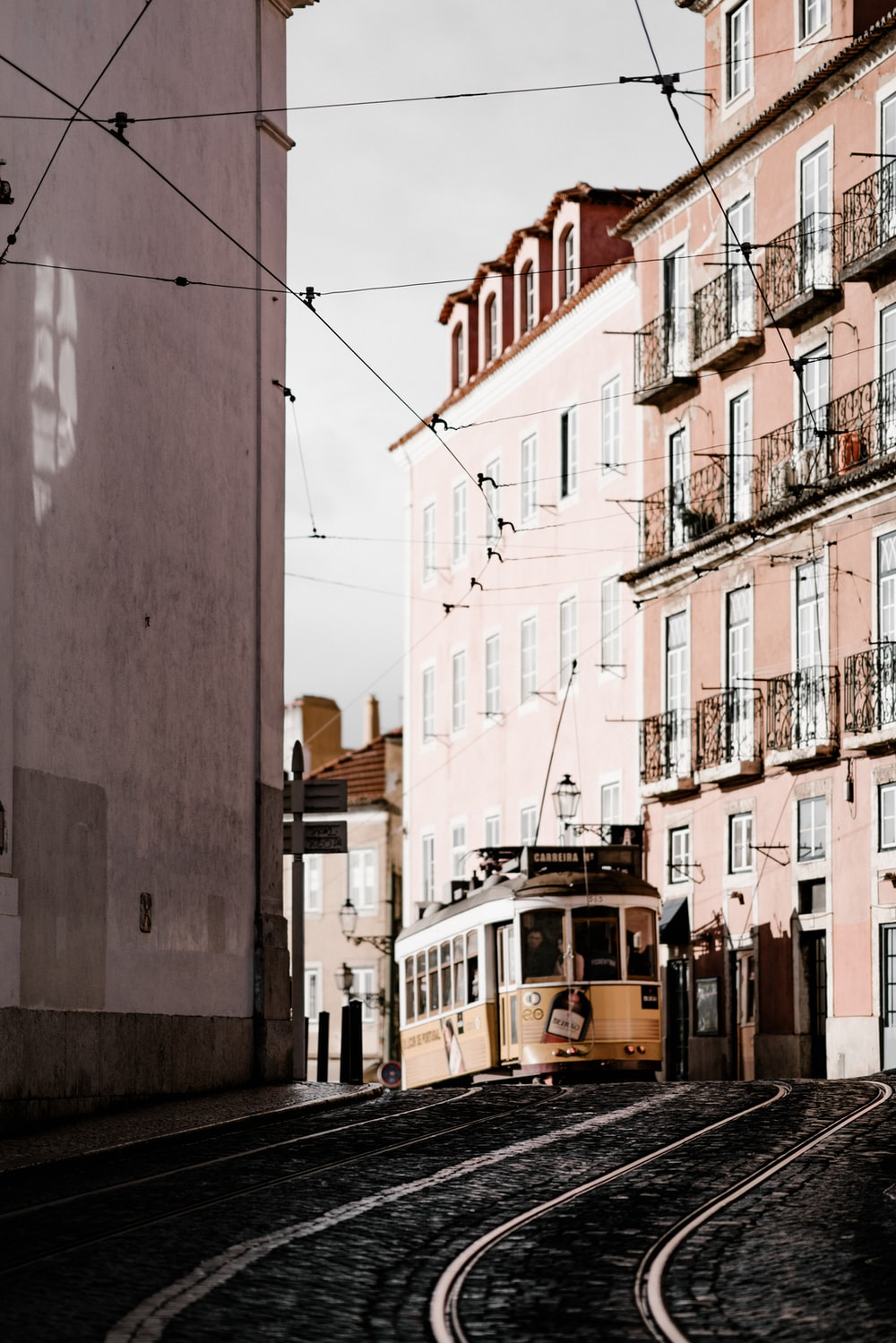 beige tram in city