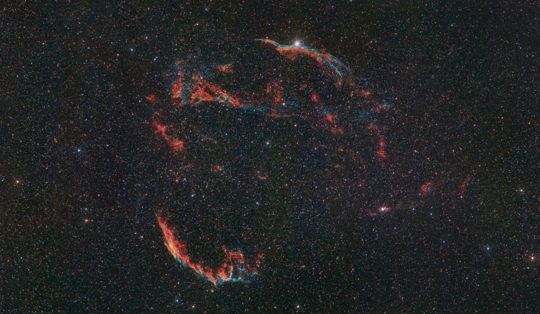 The Veil nebula, remnant of a dying star and still an astronomical mystery. This emission nebula of ionized gas is very large in size, both visually in our sky and physically in space. 6 full Moons wide and 90 light years in size, 5 to 10 thousand years old and 1500 lights years away. There is no neutron star at the center of this nebula, there is one neutron star at the base of the blowout region but of unknown distance. The intertwined rope-like filaments of oxygen, sulfur and hydrogen gas are all that remains visible of what was once  a star in our Milky way galaxy.