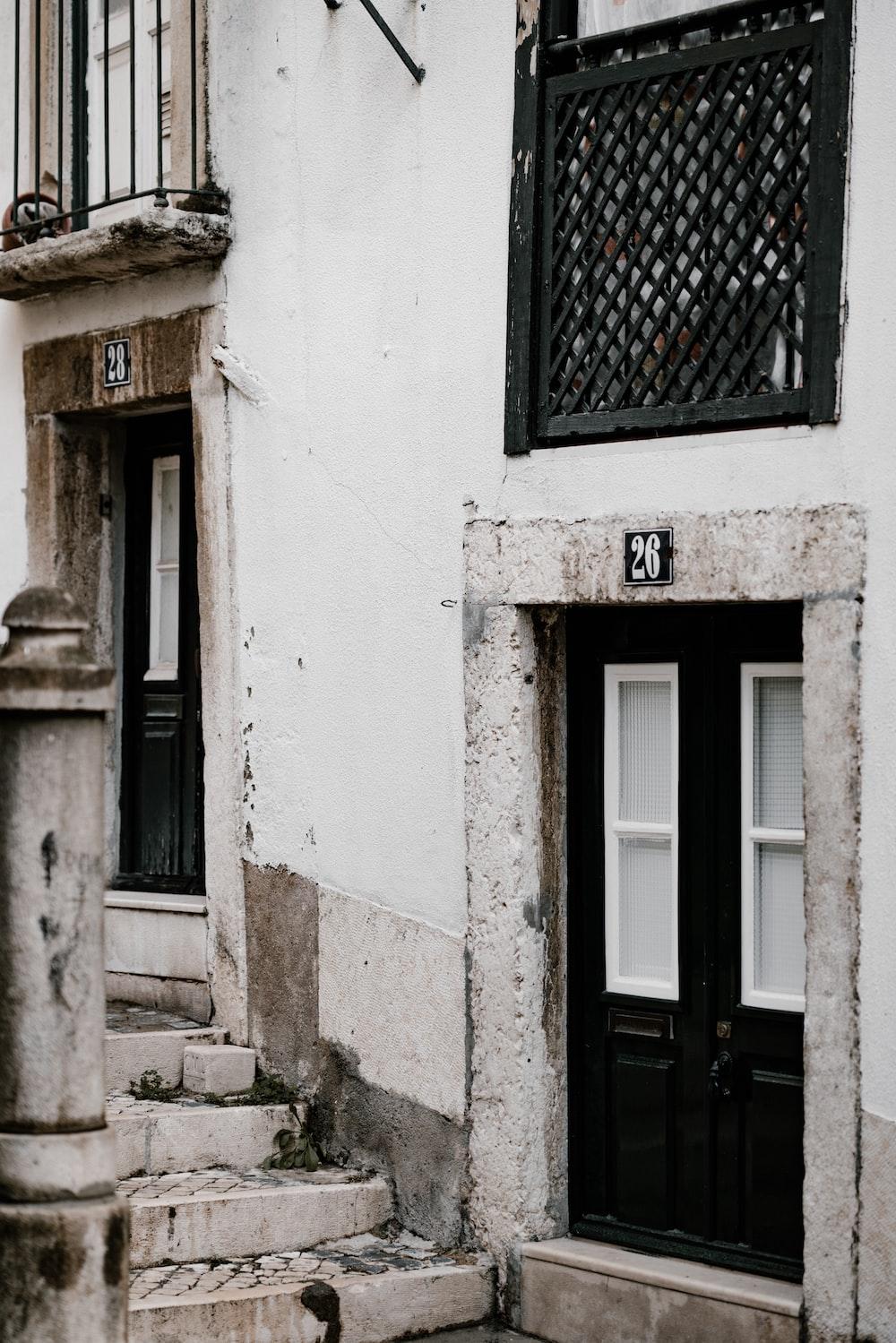 closed black wooden door on building