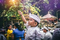 BALI, INDONESIA - JULY 4, 2018: Balinese boy with magic stick on a traditional ceremony.