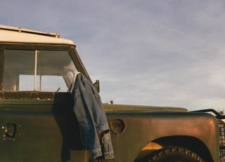blue denim jacket on vehicle mirror
