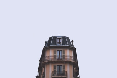 brown and black building under white sky