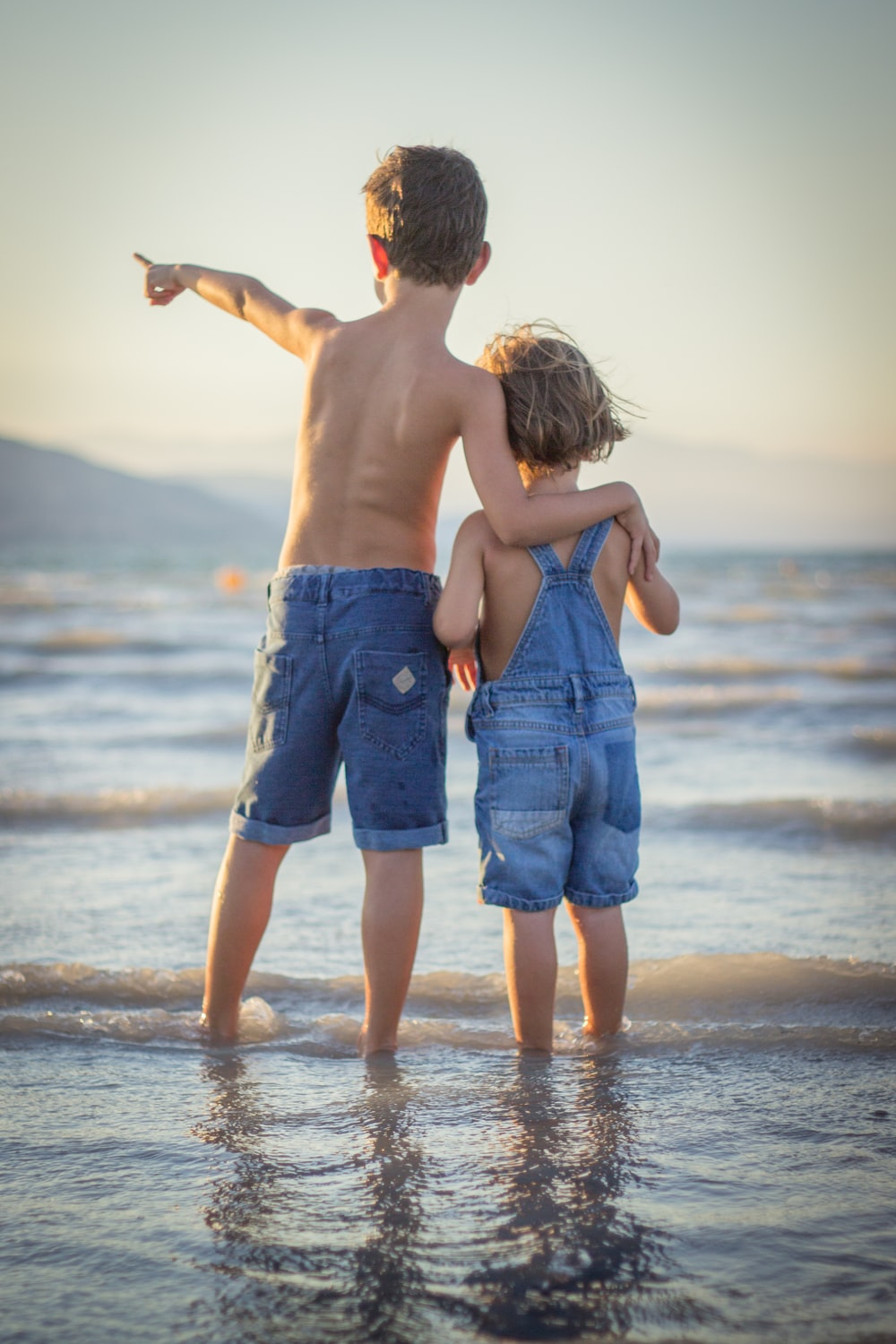 boy and girl standing at beach