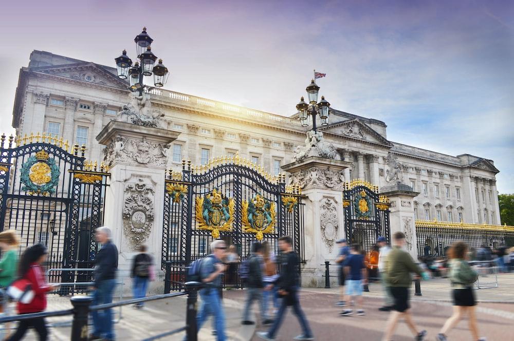 People walking outside Buckingham Palace