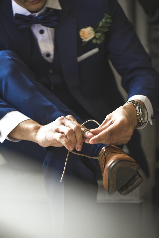 man ties his dress shoes