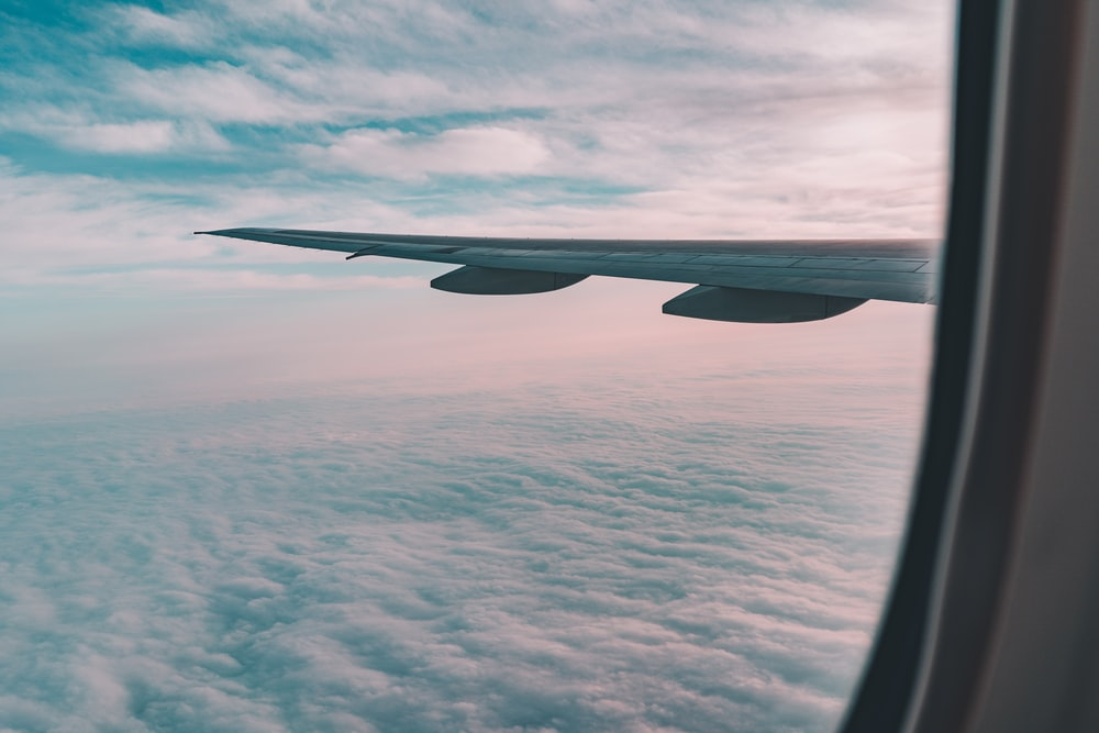 view of clouds through airplane's window