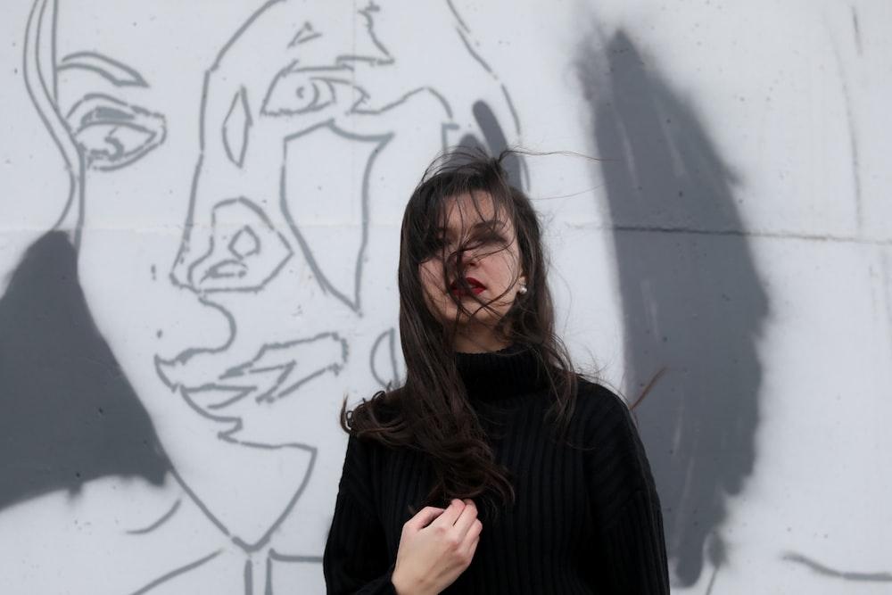 woman standing near white wall