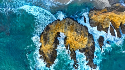 aerial view of cliff near ocean drone view teams background