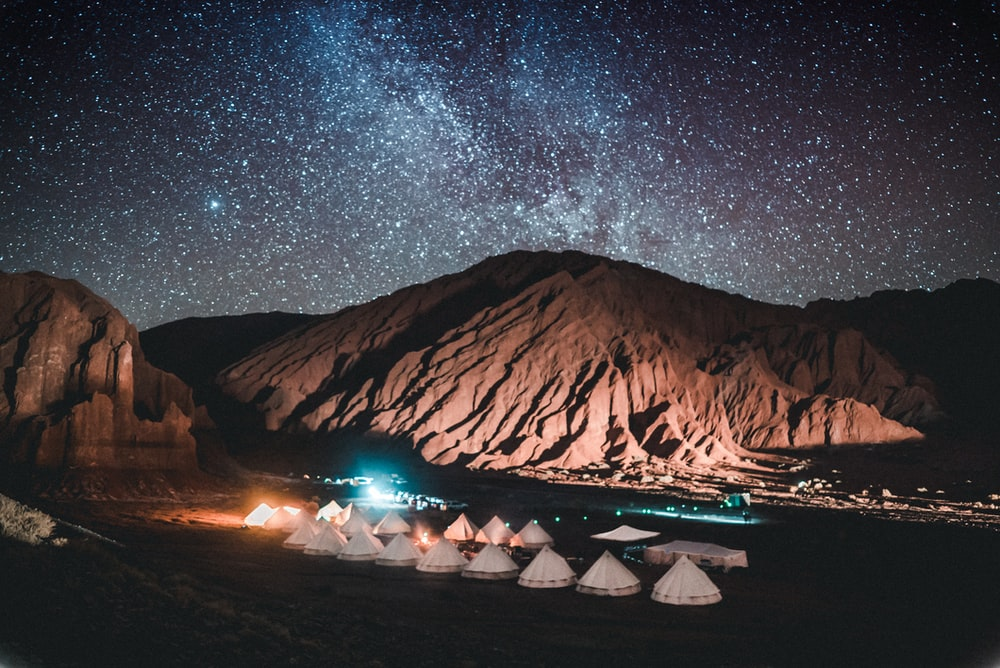 tents near mountain during night time
