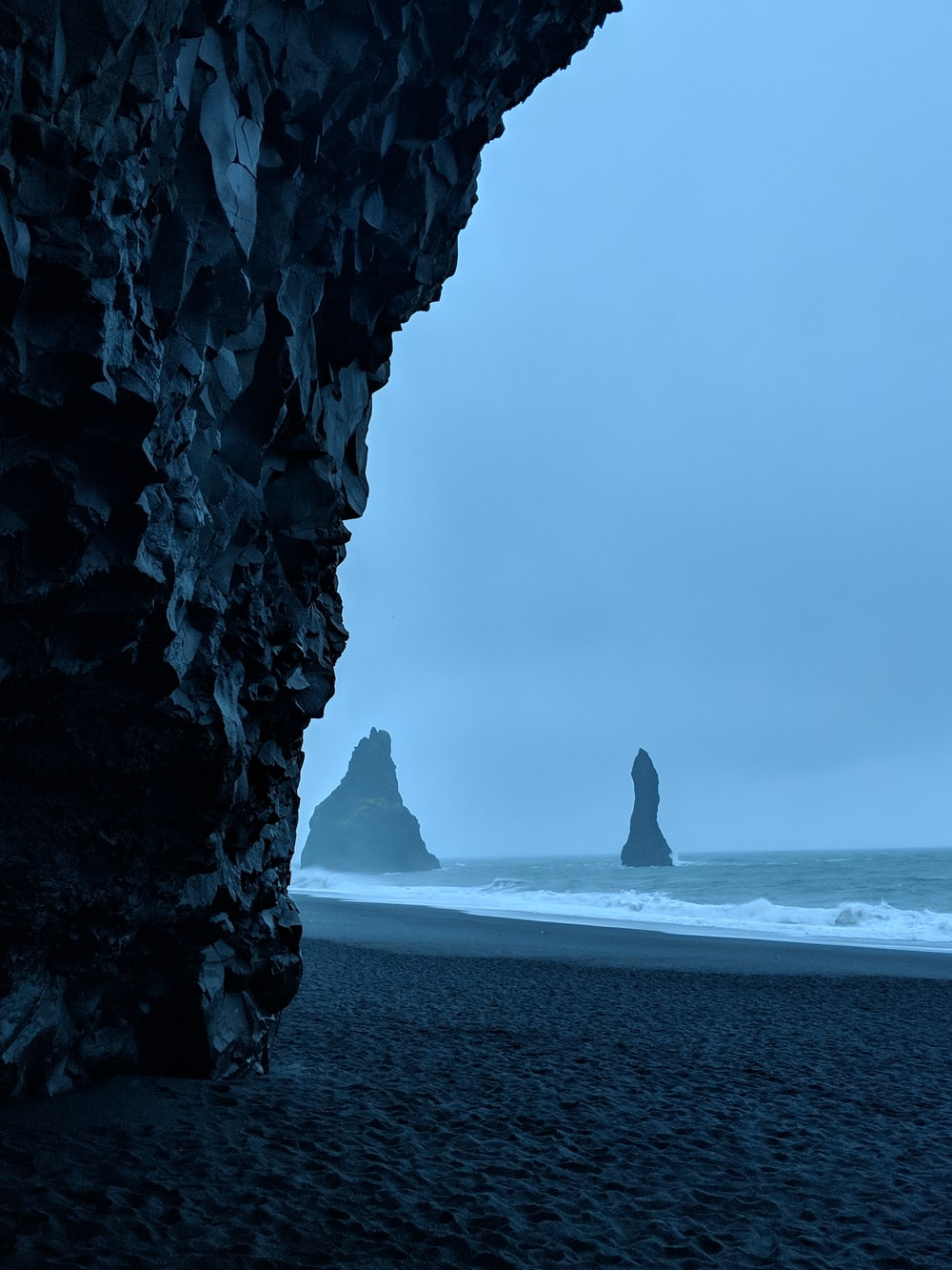 black rock formations in beach