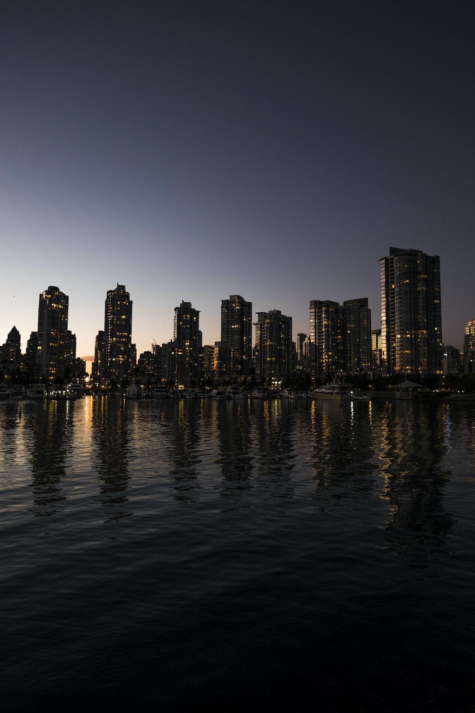 cityscape near body of water