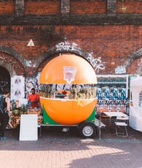 orange and green food stall