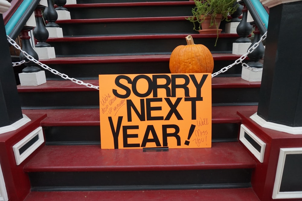 orange paper with sorry next year print