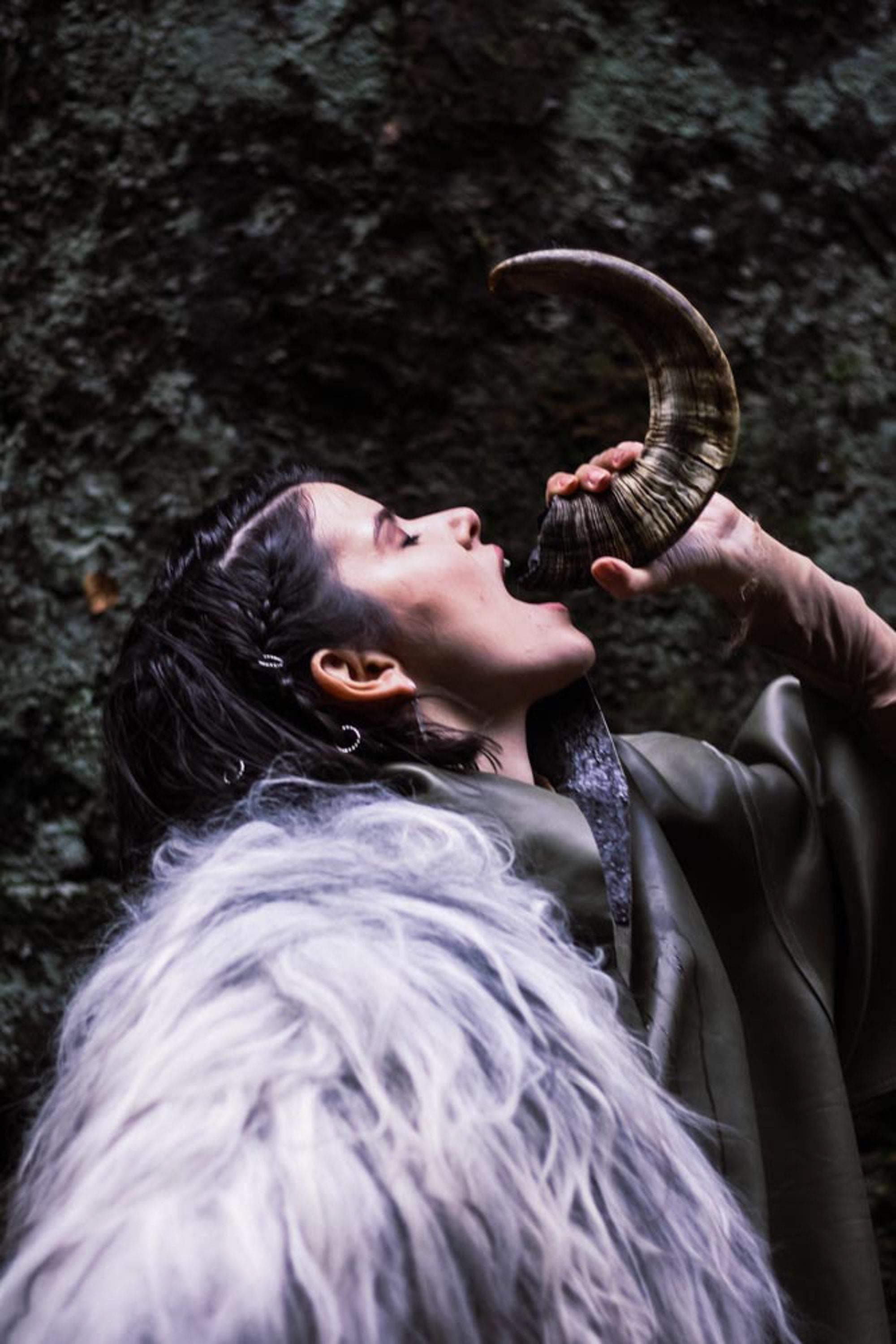 woman drinkin in horn