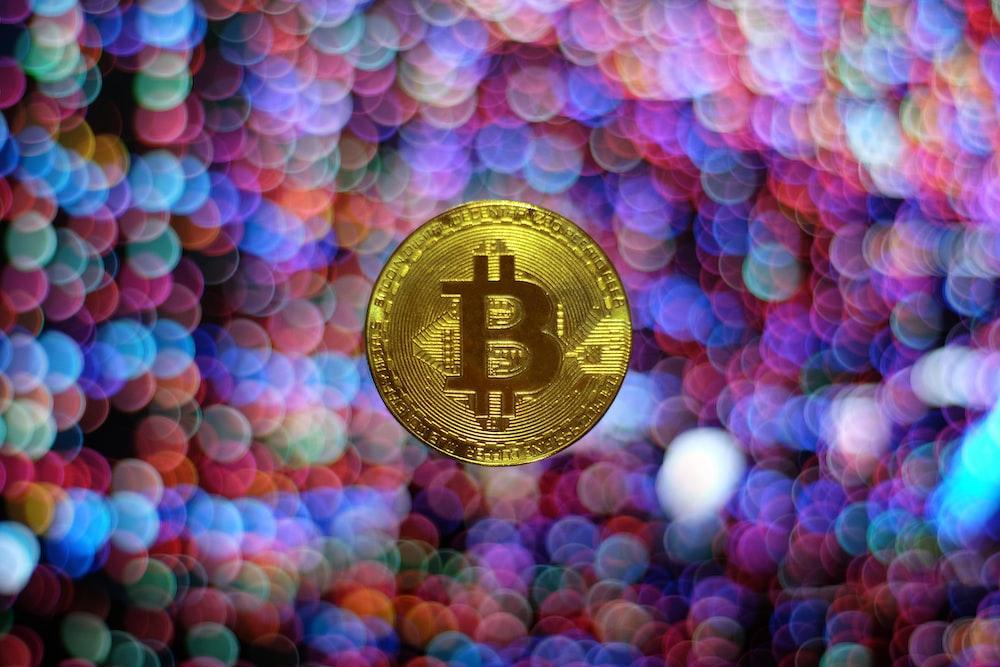 round gold-colored Bitcoin illustration