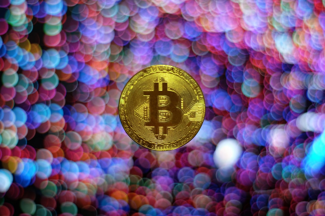 The photo was taken with a Pentax K-mount Centon 50mm F1.7 lens on a Fujifilm X-T1 body. The project involved a Bitcoin bought on eBay for 89 pence and a computer monitor to show colorful pixels for the background. I've created a little scaffolding to keep the coin in place, the bokeh is real, rendered by the lens, I used my mobile phone light to lit the coin. A little bit of shopping needed to remove the unnecessary bits and correct the colors, that's all. The project took about an hour and a half to finish.