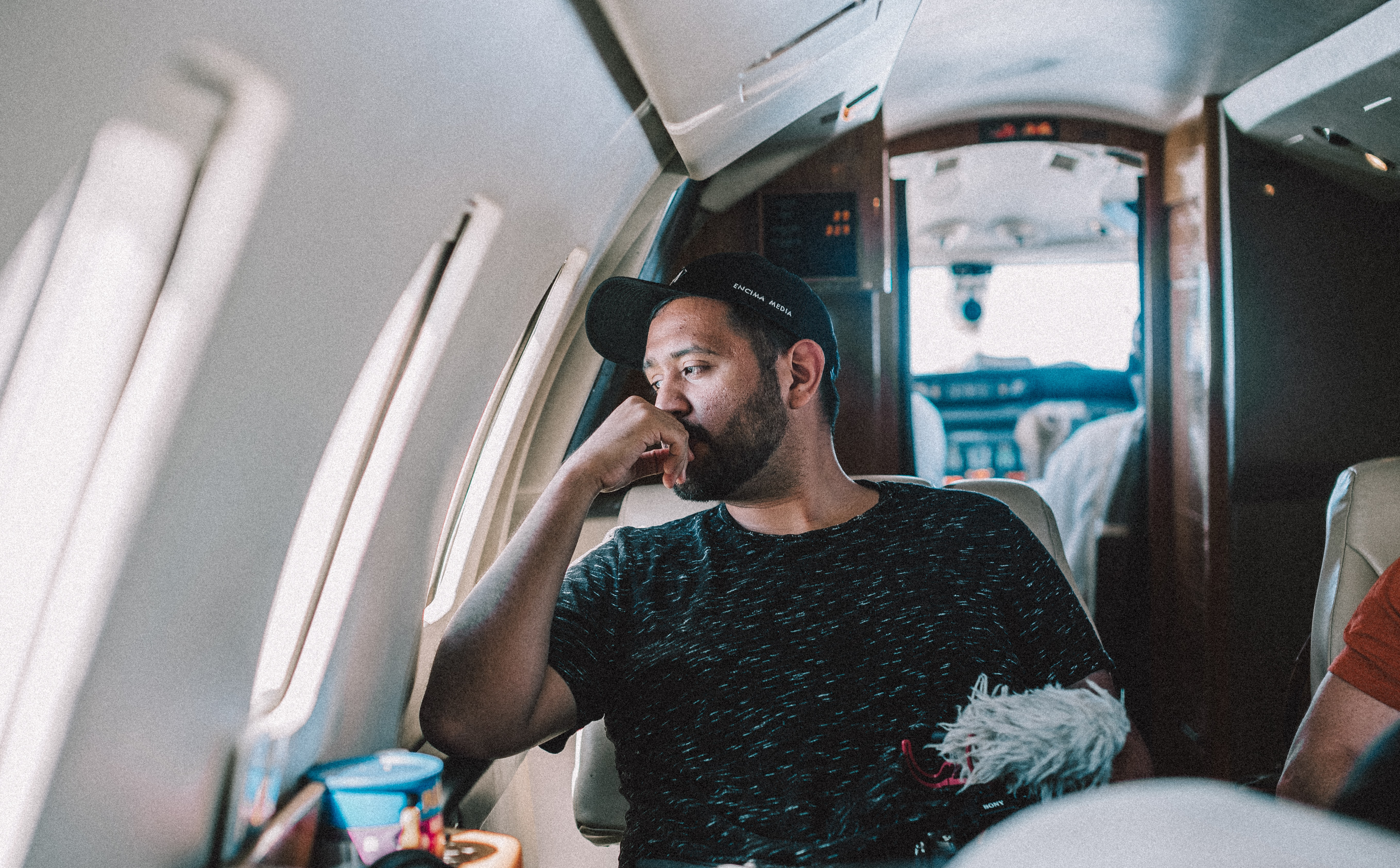man sitting inside airplane
