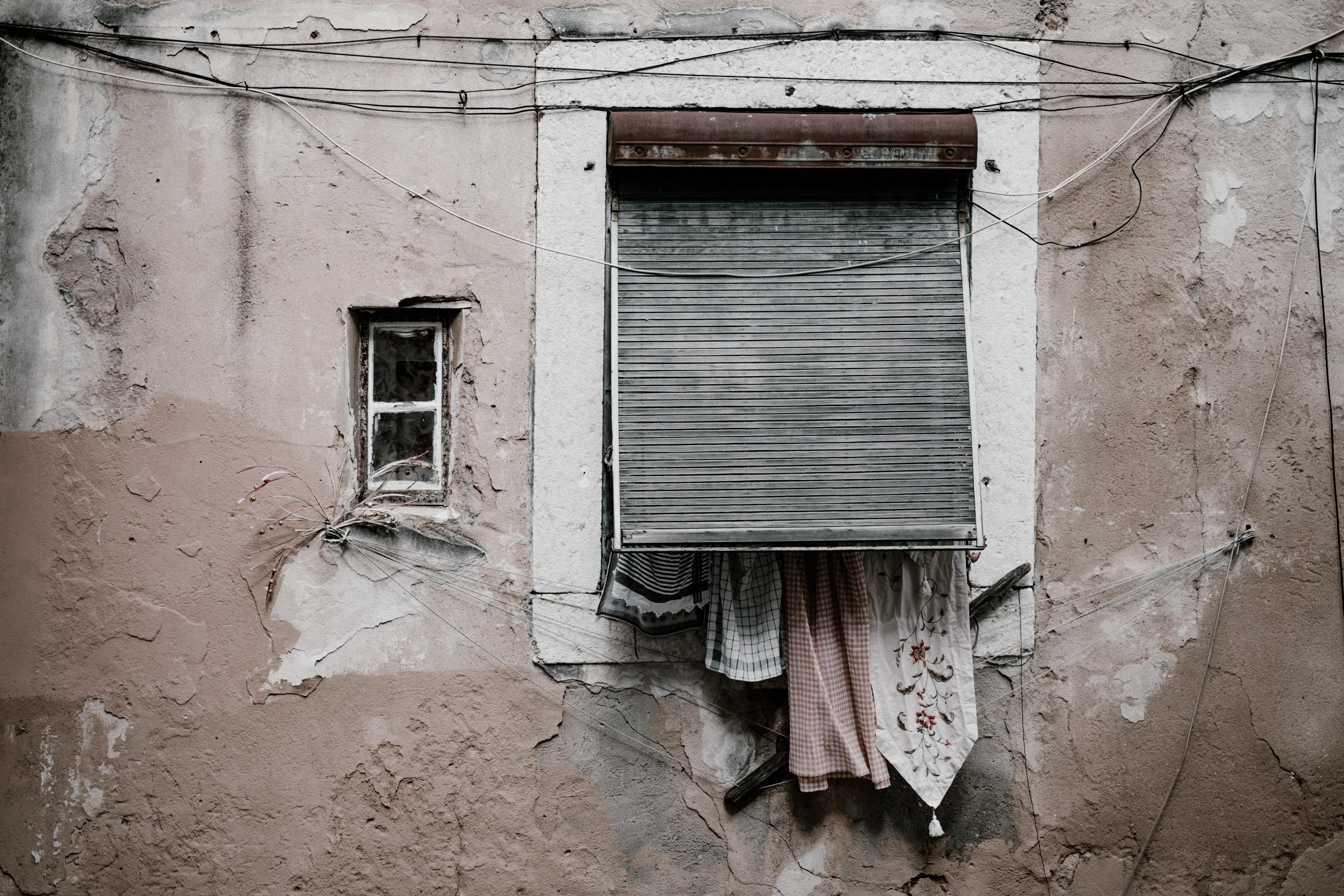 brown concrete building wth closed window