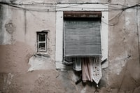 Laundry and old shutter, textured wall in Lisbon