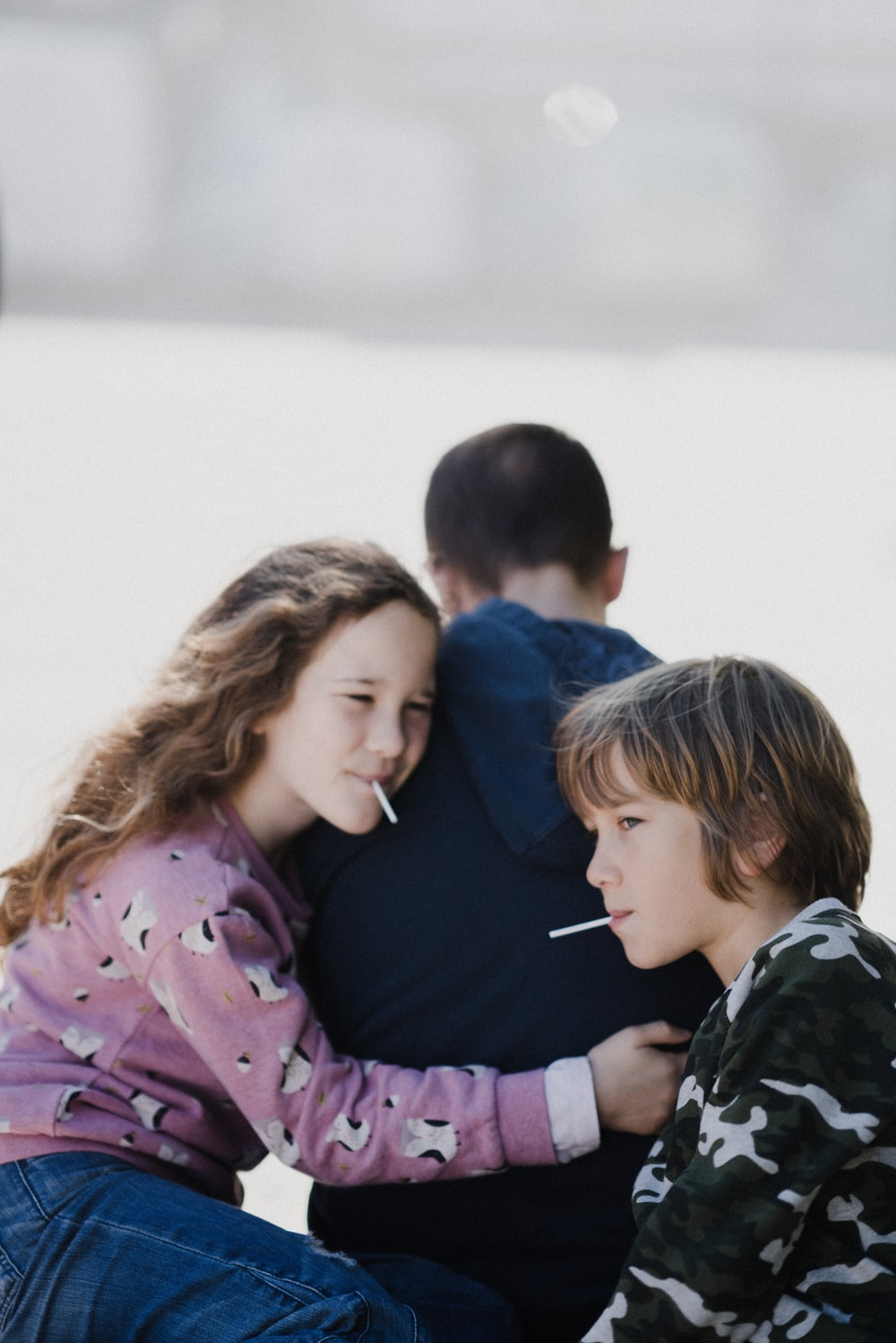 girl and boy eating lollipop