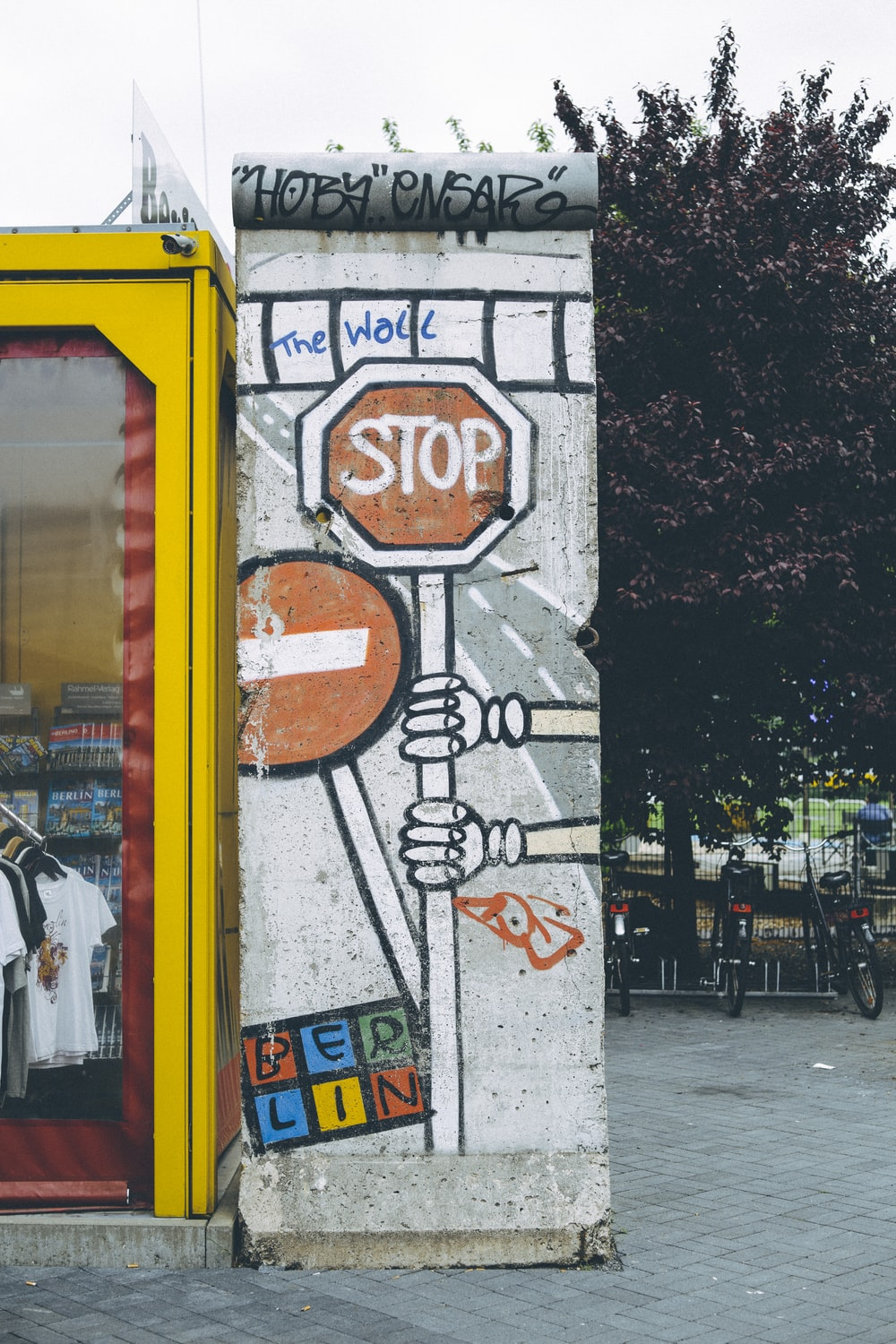 person holding Stop sign graffiti