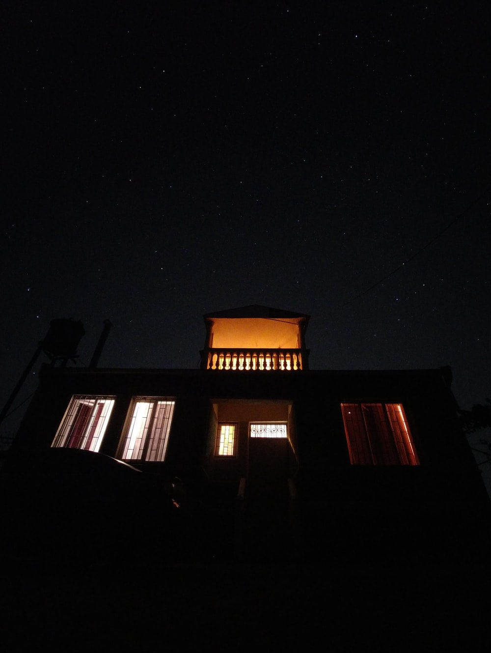 lighted house at nighttime