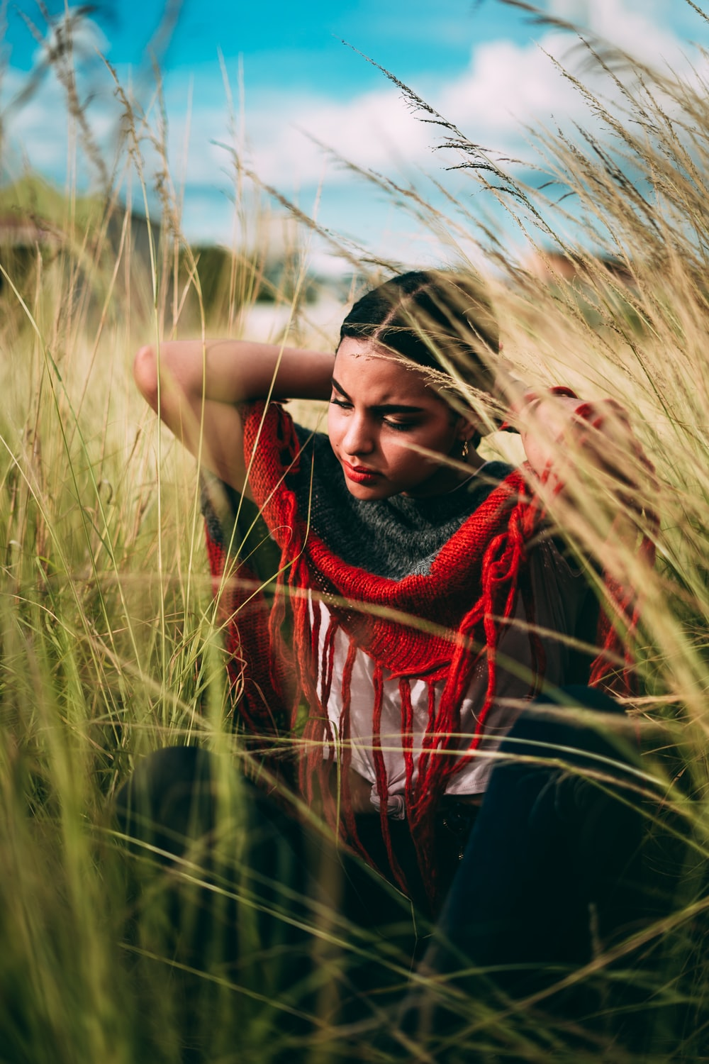 woman in black and red dress on brown plants during daytime