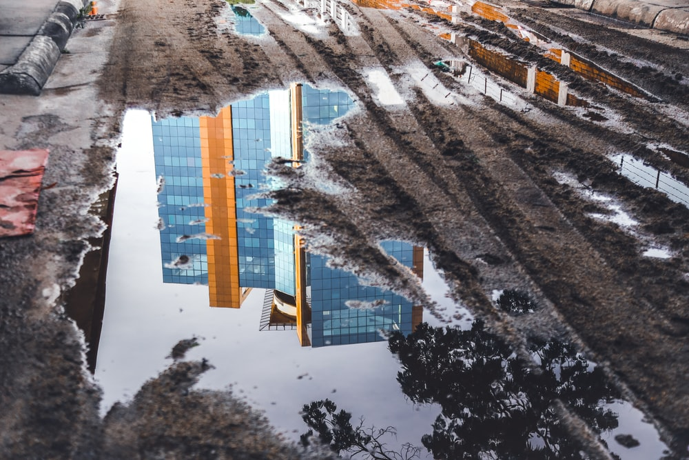 reflection of high rise building in water