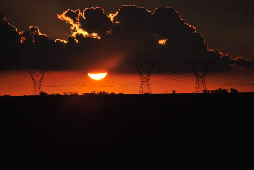 silhouette of wire towers at sunset