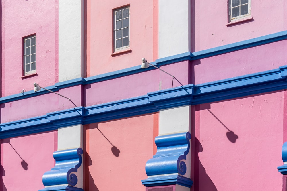 pink and blue concrete building