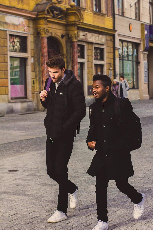 two men walking on street during daytime