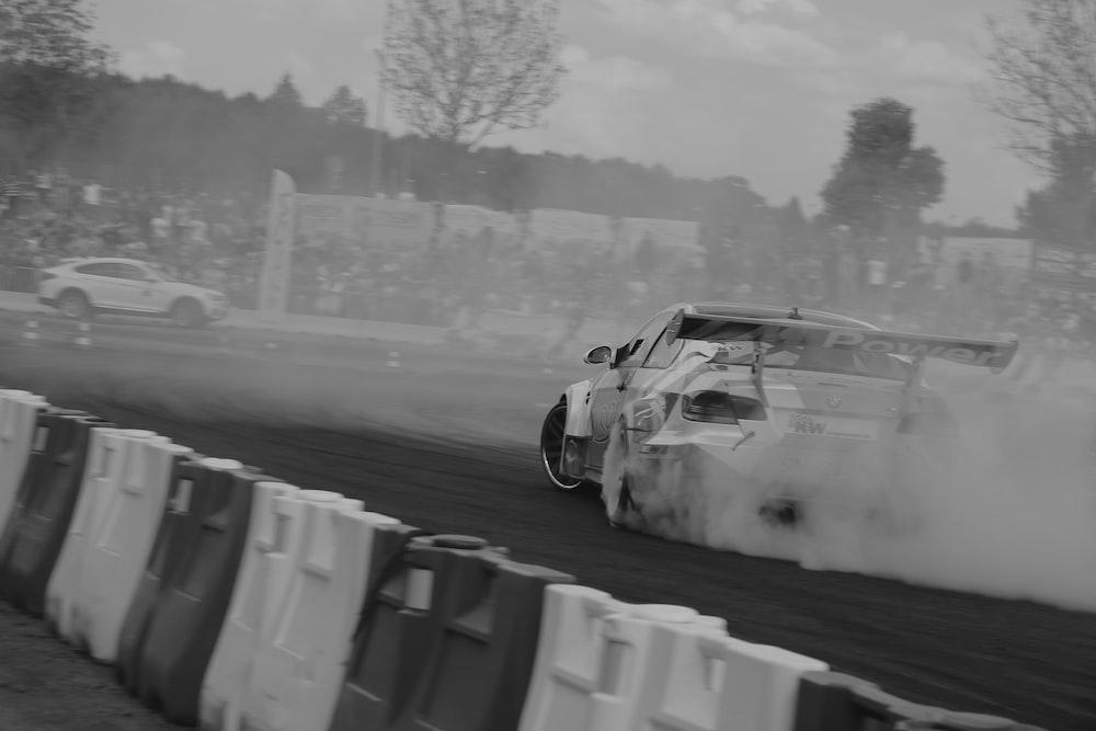 grayscale photo of vehicle drifting