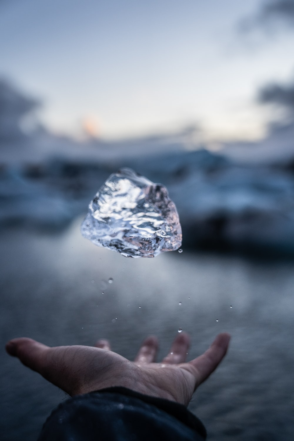 person throwing crystal stone