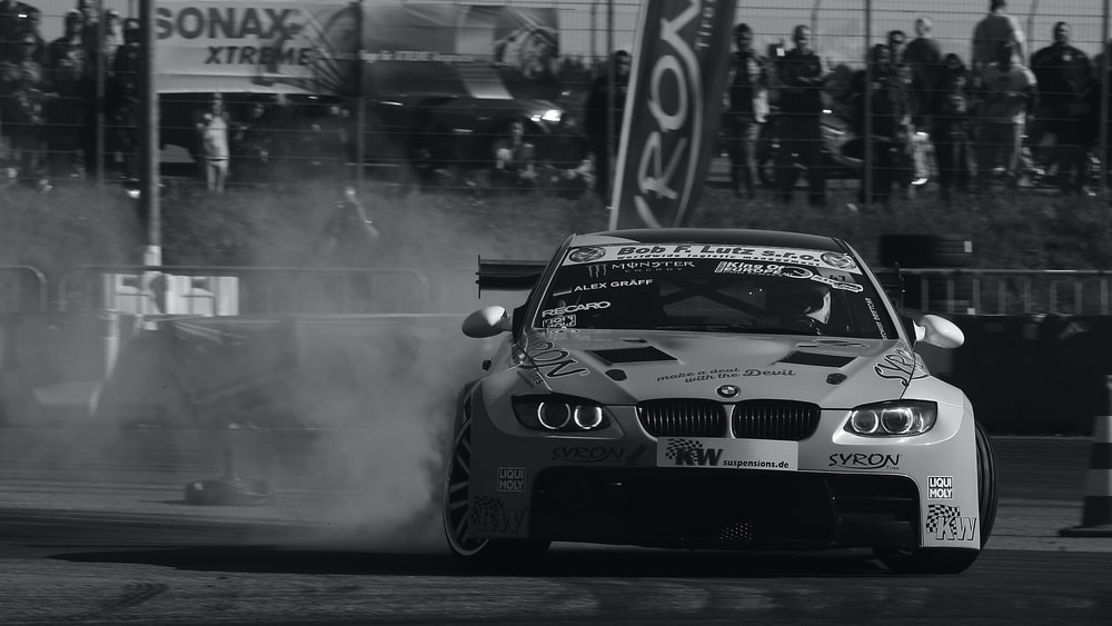 grayscale photo of BMW vehicle