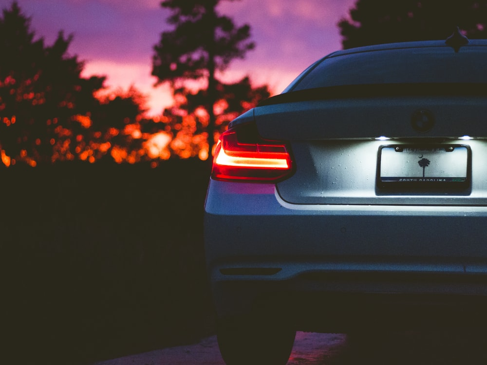 gray BMW vehicle on road at golden hour