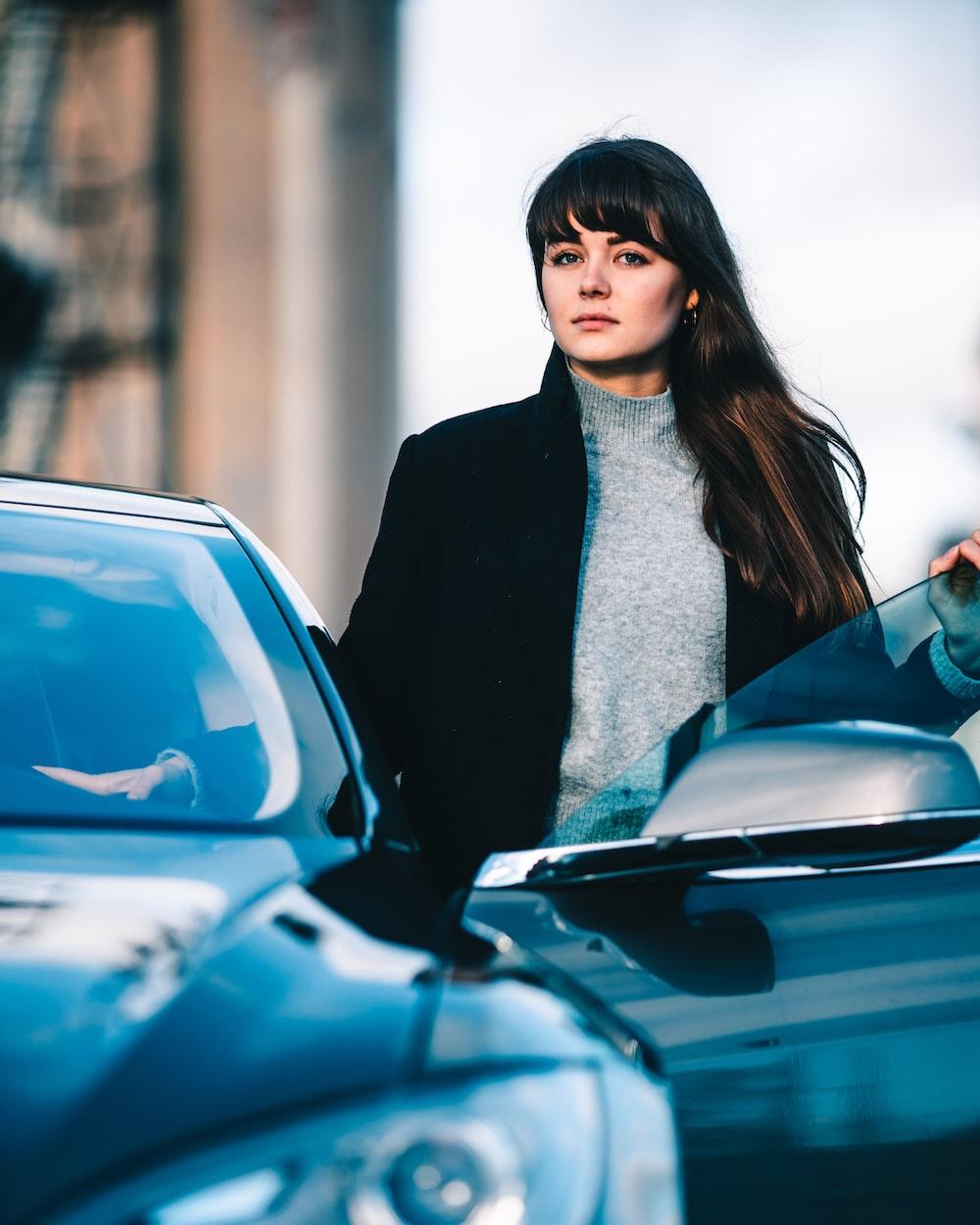 woman standing beside vehicle