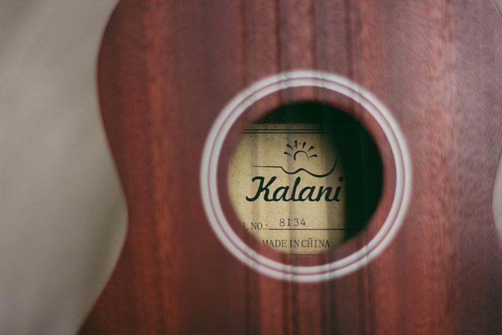Kalani guitar on white cloth