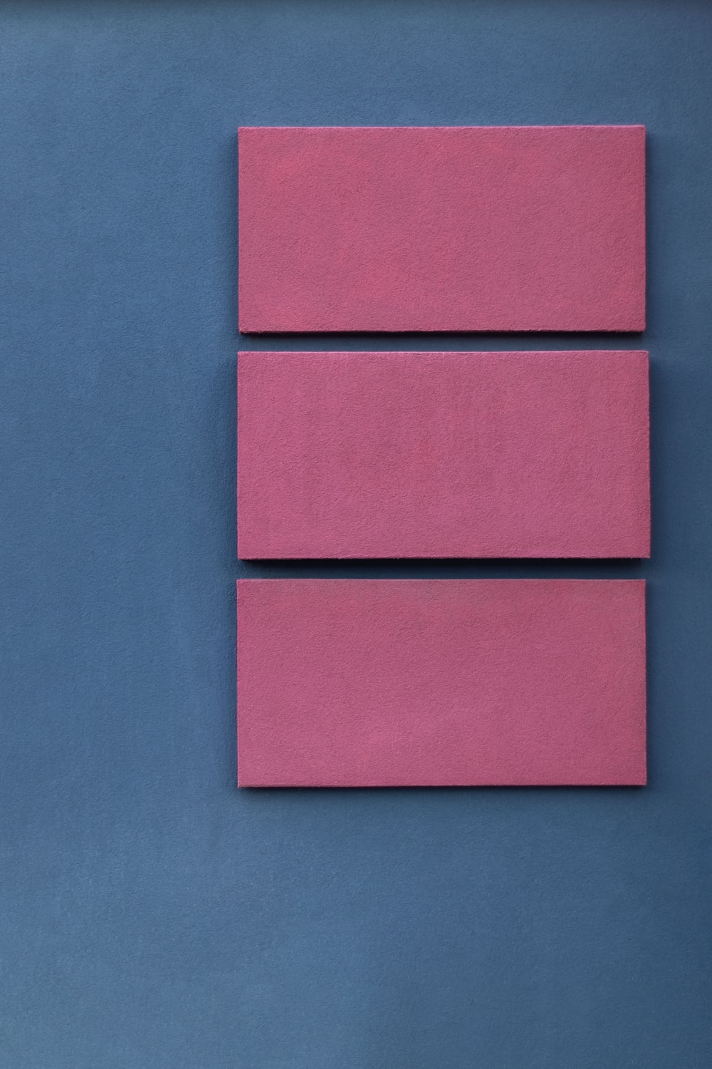 pink boards on blue surface