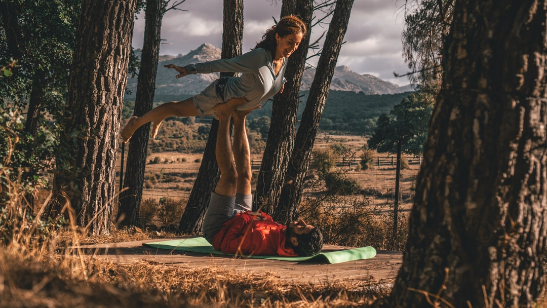 Playing some AcroYoga tricks in the wild