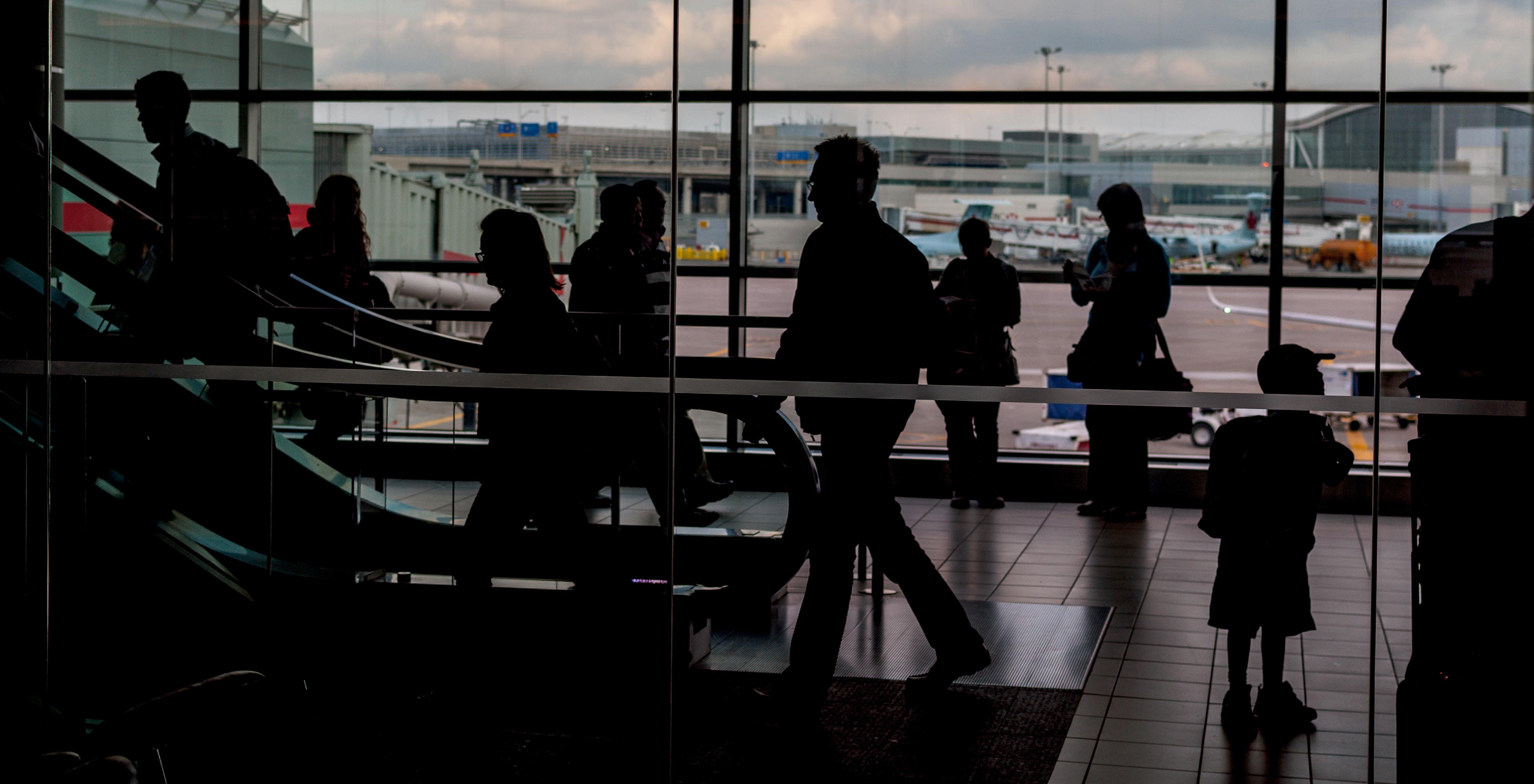 people walking inside plane station