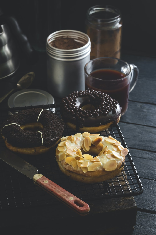doughnut beside clear glass mug