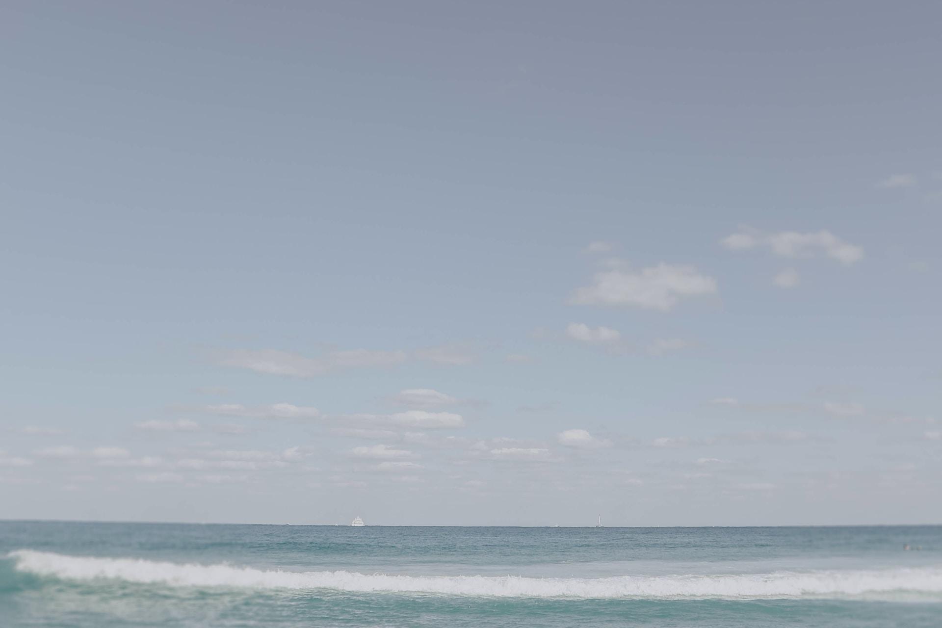 woman on seashore during daytime