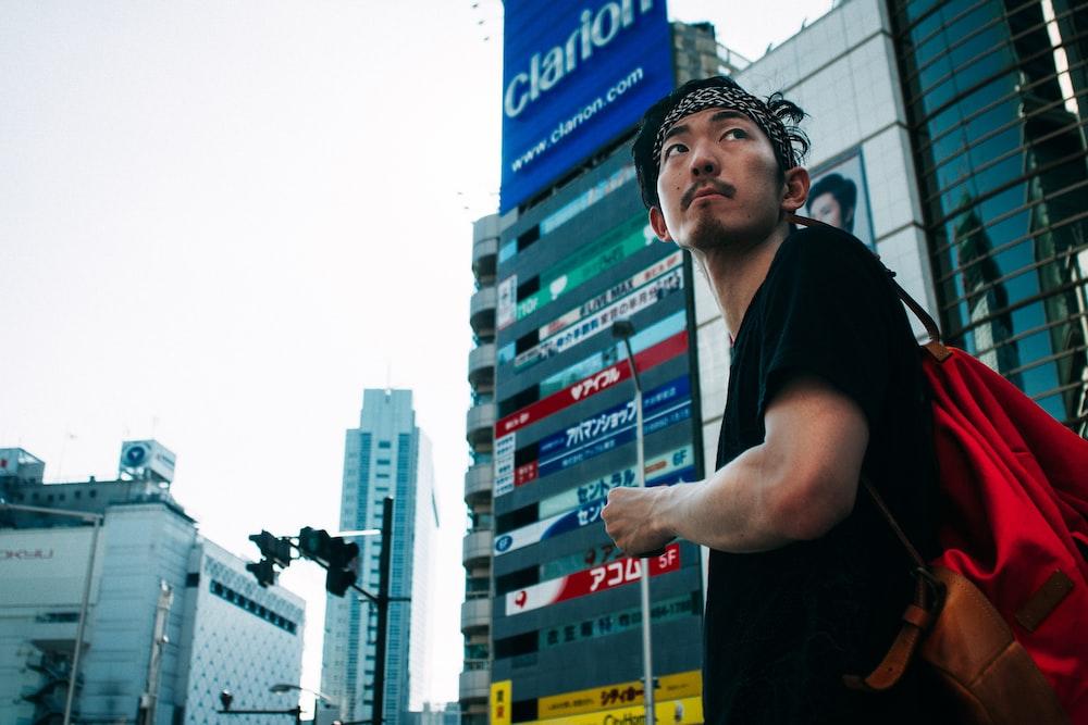 man standing near buildings