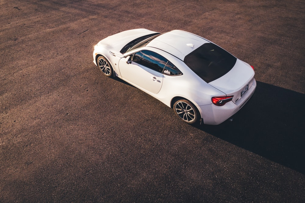 high-angle view of white coupe