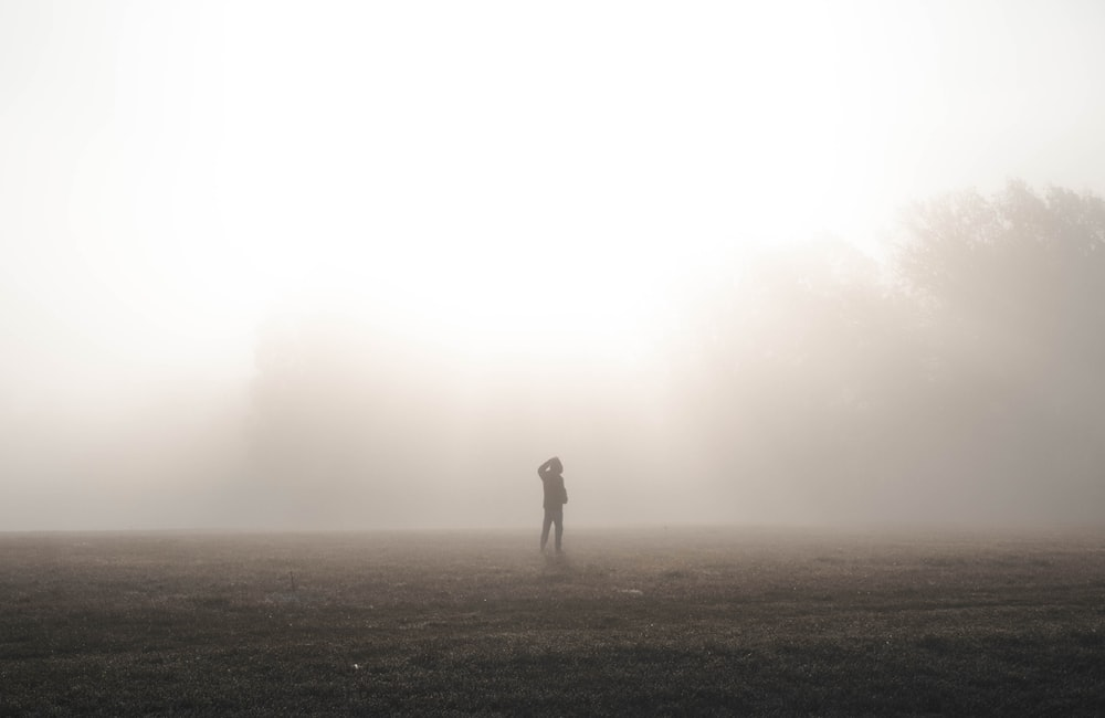 silhouette of person in dirt road