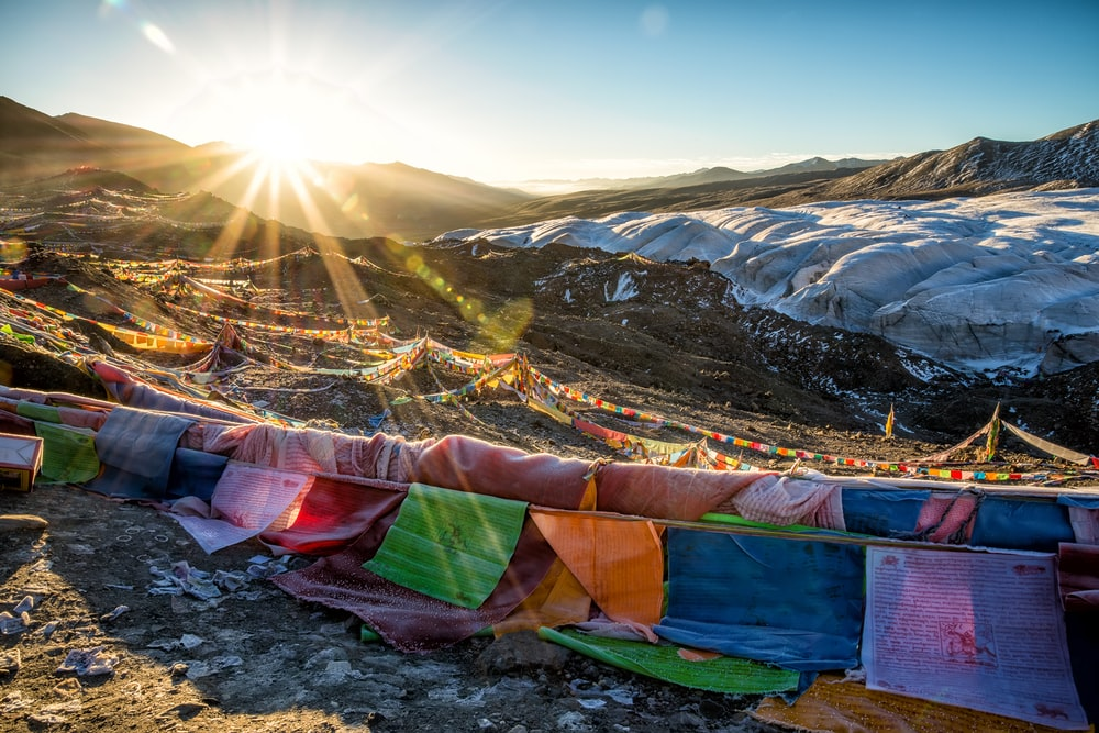 multicolored lines on hill under clear sky during sunrise