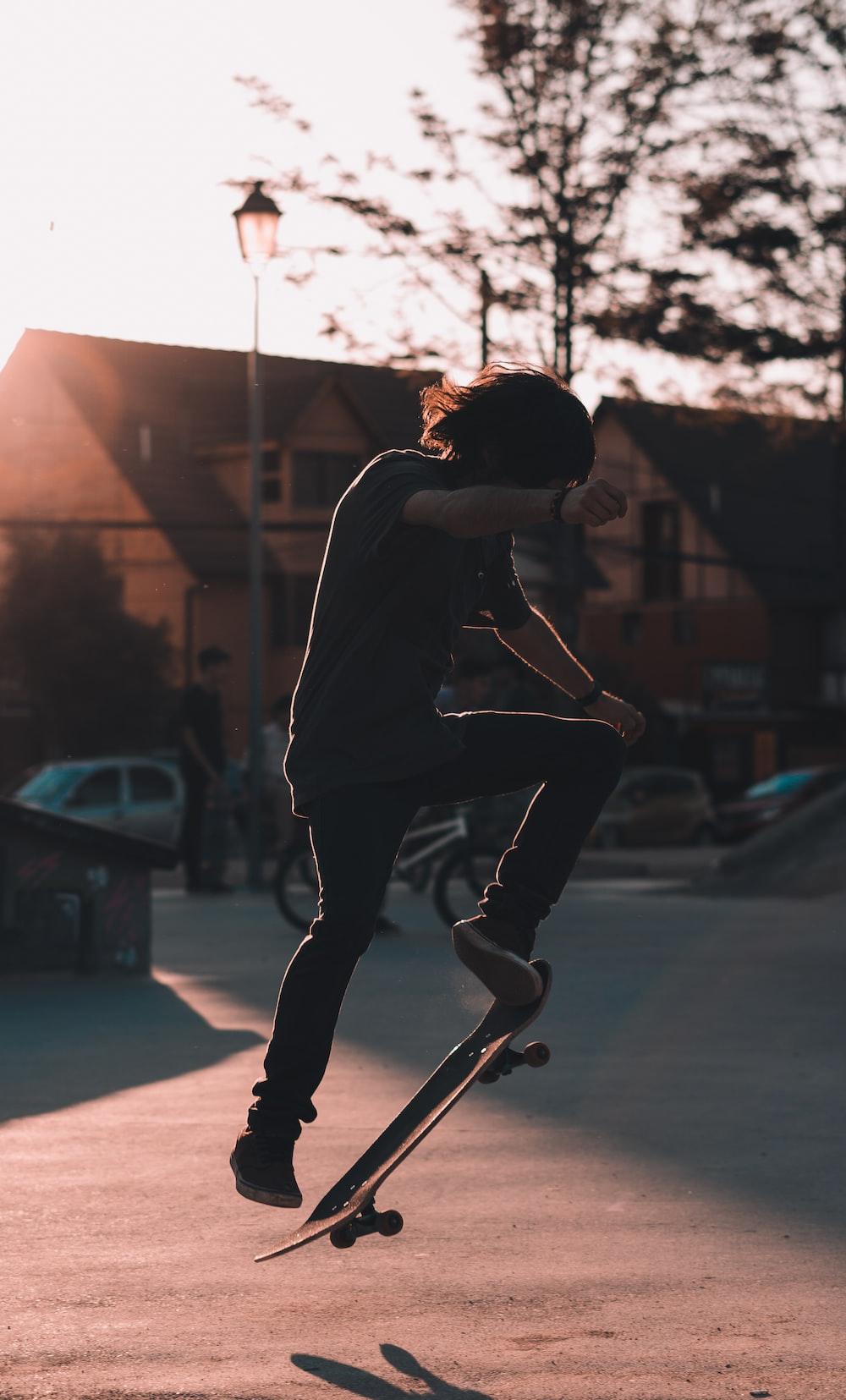 man doing skateboard trick during daytime